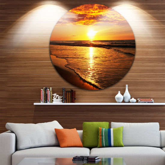 Design Art Bright Yellow Sunset over Waves Beach Metal Circle Wall Art