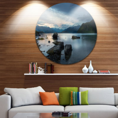 Design Art Large Rocks and Distant Cloudy Mountains Landscape Metal Circle Wall Art