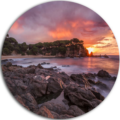 Design Art Gloomy Seashore with Large Rocks Seascape Metal Circle Wall Art
