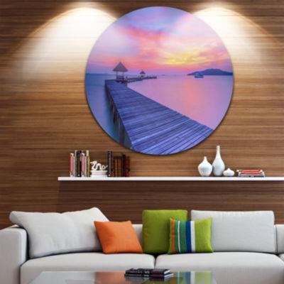 Design Art Purple Tinged Wood Bridge and Beach Pier Seascape Metal Circle Wall Art