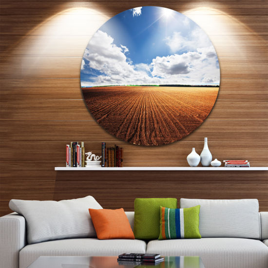 Design Art Expansive Field under White Clouds Landscape Metal Circle Wall Art