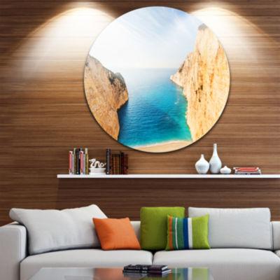 Design Art Blue Sea in Between Big Rocks Extra Large Seashore Metal Circle Wall Art