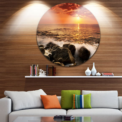 Design Art Bright Sunset over Rocky Shore SeashoreMetal Circle Wall Art