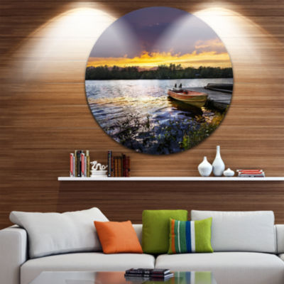 Design Art Boat Docked in Lake at Sunset SeashoreMetal Circle Wall Art