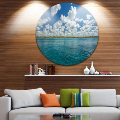 Design Art White Fluffy Clouds Over Sea OversizedBeach Metal Circle Wall Art