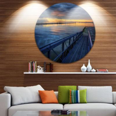Design Art Azure Waters Behind Pier Seascape Circle Metal Wall Art