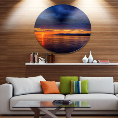 Design Art Blue Cloudy Sky and Setting Sun Seashore Photo Metal Circle Wall Art