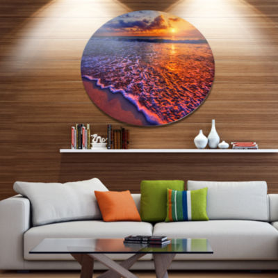 Design Art Colorful Sunset and Wavy Waters Seashore Metal Circle Wall Art
