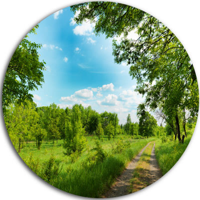 Designart Green Forest Road and Blue Sky Modern Landscape Circle Metal Wall Art