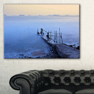 Designart Abandoned Pier Into Blue Sea Canvas Art