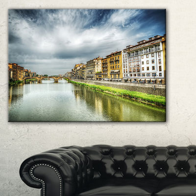 Designart Arno River Under Dramatic Sky Canvas Art