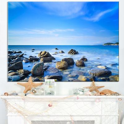 Designart Baratti Bay Rocks In Waters At Sunset Canvas Art