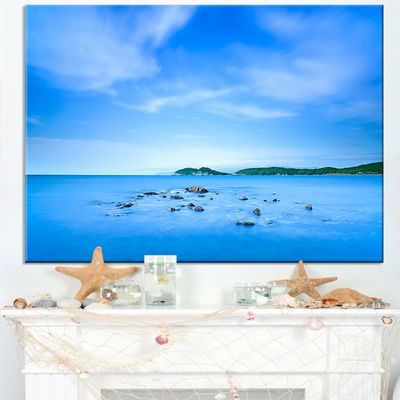 Designart Baratti Bay Small Rocks In Blue Sea Canvas Art