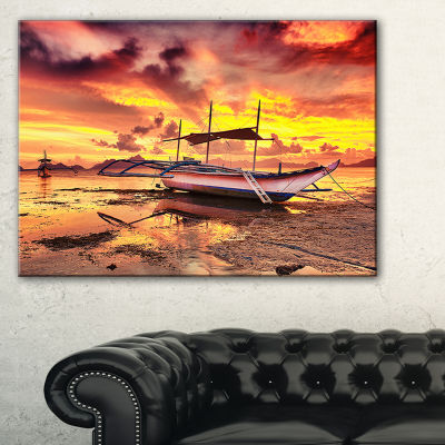 Designart Beautiful Boat Under Yellow Sky Canvas Art