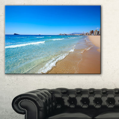 Designart Benidorm Poniente Beach Waves Canvas Art