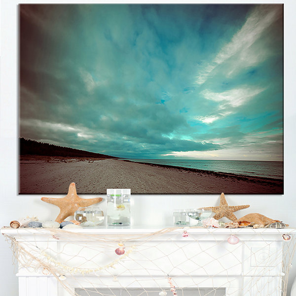 Designart Blue Baltic Beach In Fall With Clouds Canvas Art