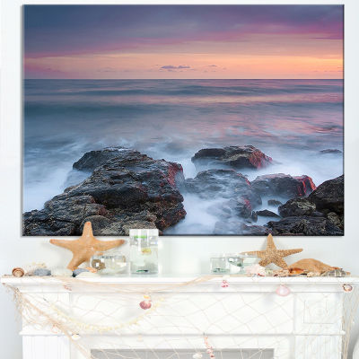 Designart Blue Rocky Sea Beach Sunset Canvas Art