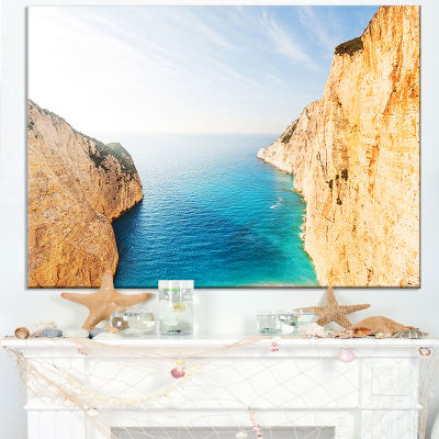 Designart Blue Sea In Between Big Rocks Canvas Art
