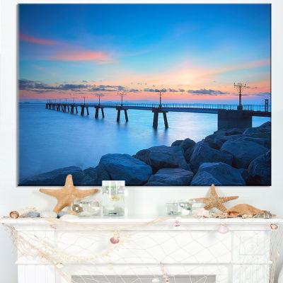 Designart Bluish Rocky Seashore With Pier Canvas Art