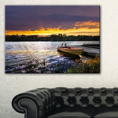 Designart Boat Docked In Lake At Sunset Canvas Art