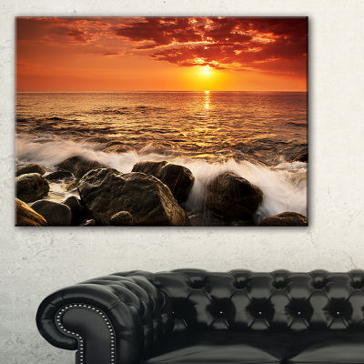 Designart Bright Sunset Over Rocky Shore Canvas Art