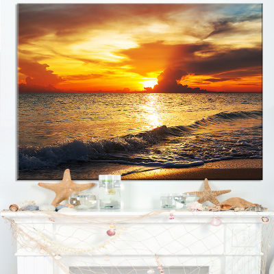 Designart Colorful Dramatic Sunset Over Waves Canvas Art