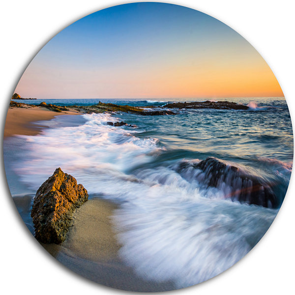 Design Art White Waves Crashing on Rocks SeascapeMetal Circle Wall Art