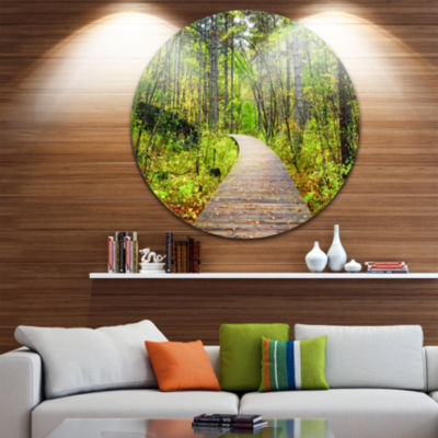 Designart Wooden Boardwalk across Forest LandscapeRound Circle Metal Wall Art