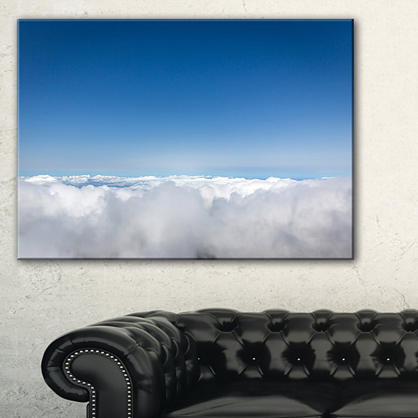 Designart Aerial View Of Sky Over Clouds Canvas Art