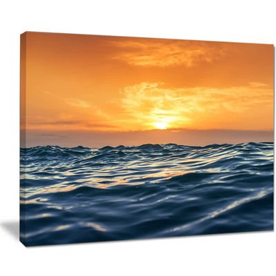 Designart Blue Waves Dancing At Yellow Sunset Canvas Art