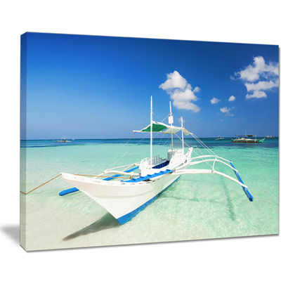 Designart Boat In Blue Sea Water Canvas Art