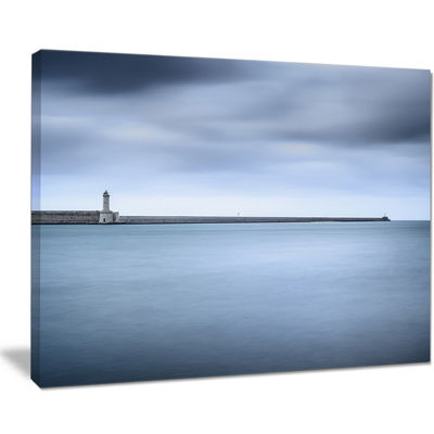 Designart Breakwater And Soft Water Under Clouds Canvas Art