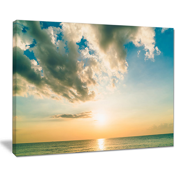 Designart Clouds Together Over Blue Seashore Canvas Art