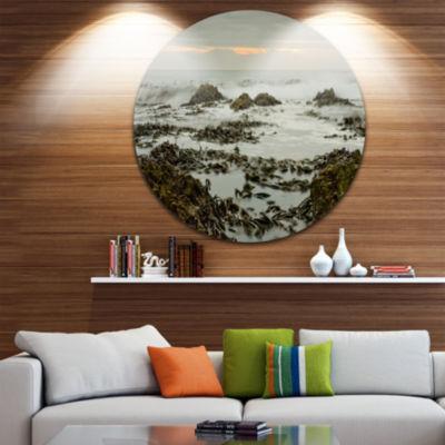 Design Art Gloomy Sunset over Rocks and Waves Seascape Metal Circle Wall Art