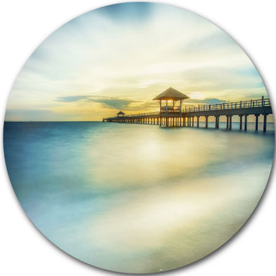 Design Art Blue Tinged Seashore with Distant PierPier Seascape Metal Circle Wall Art