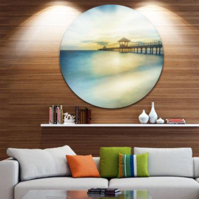 Design Art Blue Tinged Seashore with Distant PierPier Seascape Metal Circle Wall Art