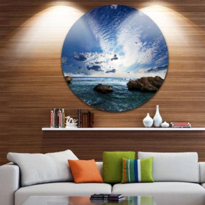 Design Art Rocky Beach with White Clouds Beach Metal Circle Wall Art