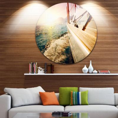 Design Art Huge Yacht Sailing Against Sunset PierMetal Circle Wall Art