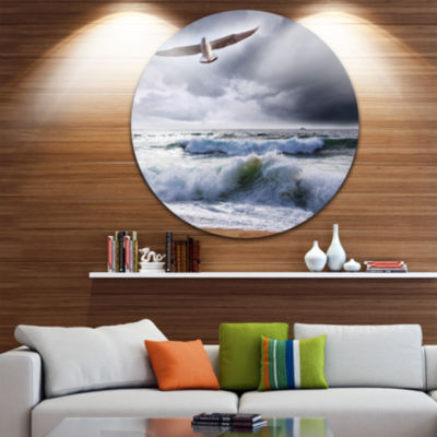 Design Art Large Seagull over Stormy Waves Beach Metal Circle Wall Art