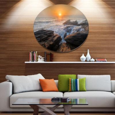 Designart Sunset over Rocky SeashoreBeach Photo Metal Circle Wall Art