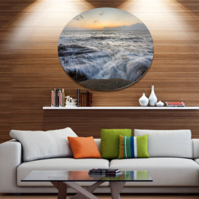 Designart Troubled Sunset Sea WavesBeach Photo Metal Circle Wall Art