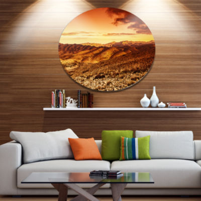 Designart Cloudy Dramatic Sunset in DesertExtra Large Landscape Metal Circle Wall Art