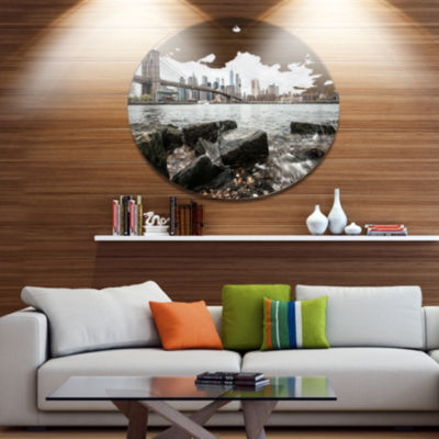 Designart Brooklyn Bridge with Rocks on Shore DiscLarge Cityscape Metal Circle Wall Art