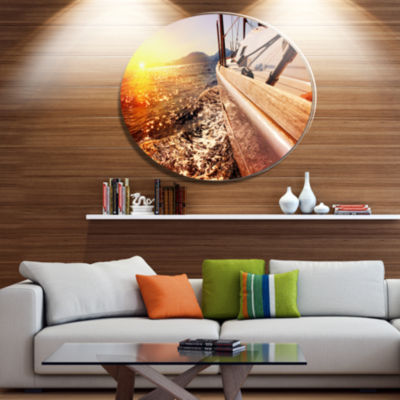 Designart Yacht Sailing against Sunset Disc LargeSeashore Metal Circle Wall Art