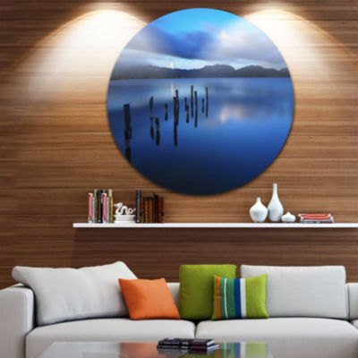 Design Art Dark Blue Sea with Pier Remains Seascape Circle Metal Wall Art