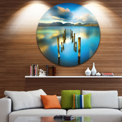 Design Art Cloudy Lake with Broken Pier Seascape Circle Metal Wall Art