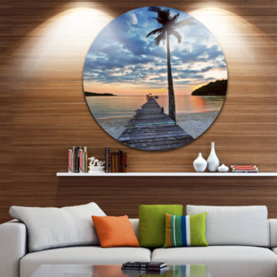 Design Art Wooden Pier and Palm Tree Seashore Photo Circle Metal Wall Art