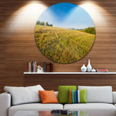 Design Art Sunrise Over Green Mountains Circle Metal Wall Art
