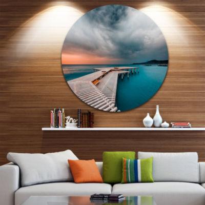 Design Art Pier in Ocean in Cloudy Day Circle Metal Wall Art