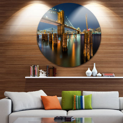 Designart Lit up Brooklyn Bridge by Night Cityscape Photo Circle Metal Wall Art